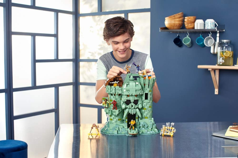 boy playing with a Mega Construx Castle