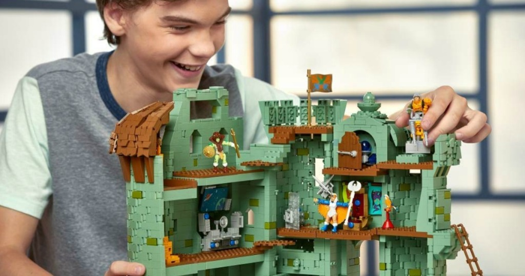 boy playing with Mega Construx He-Man Castles