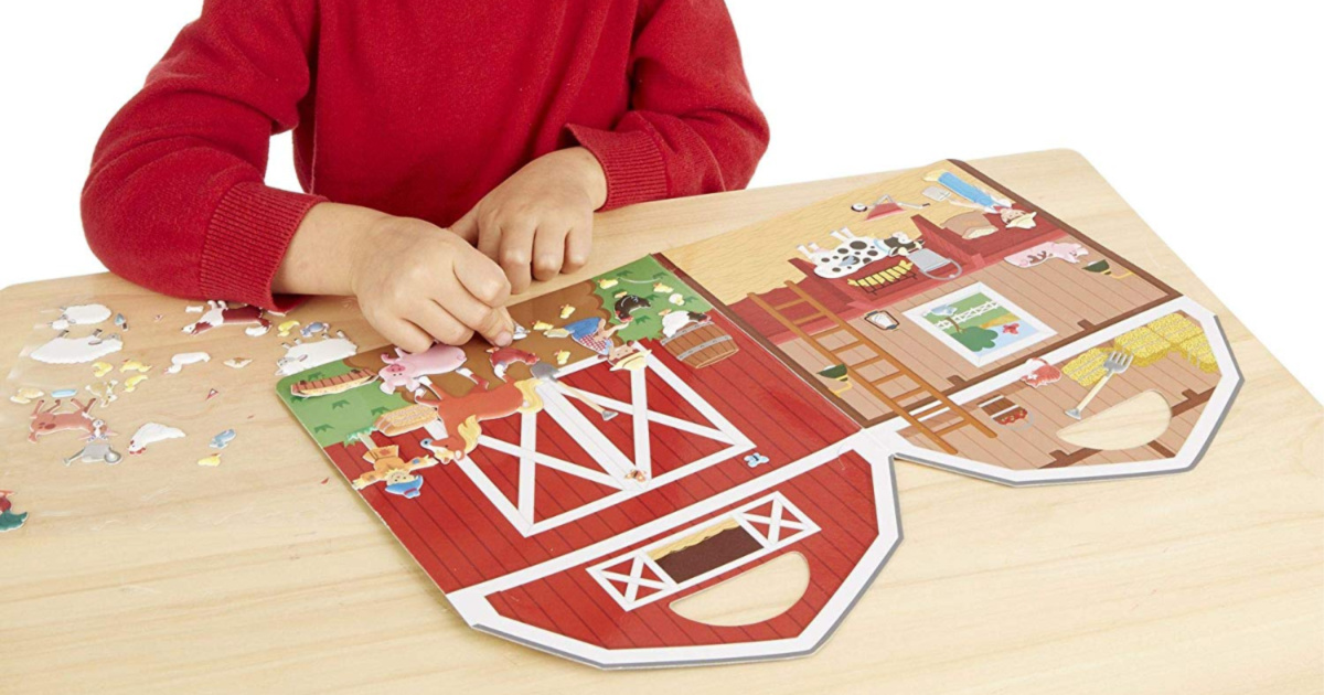 boy playing with melissa and doug sticker set