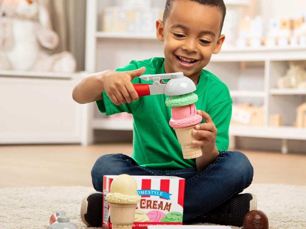 boy playing with ice cream set