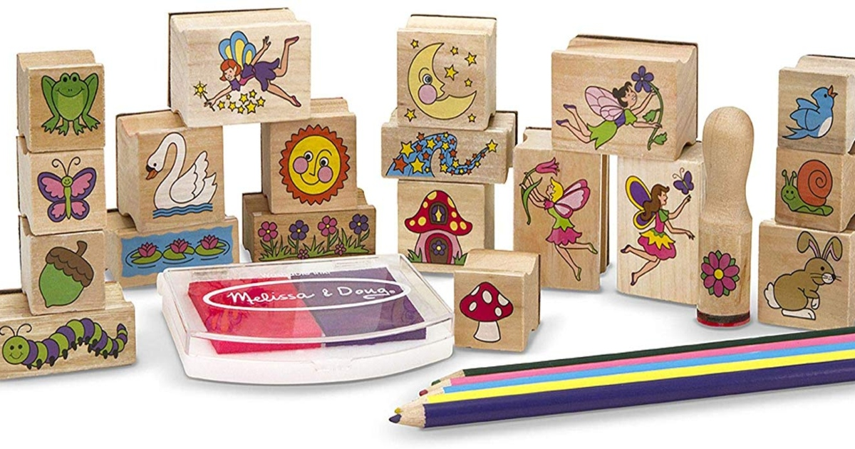 Melissa & Doug Wooden stamp set. All lined up with stamp pad and pencils