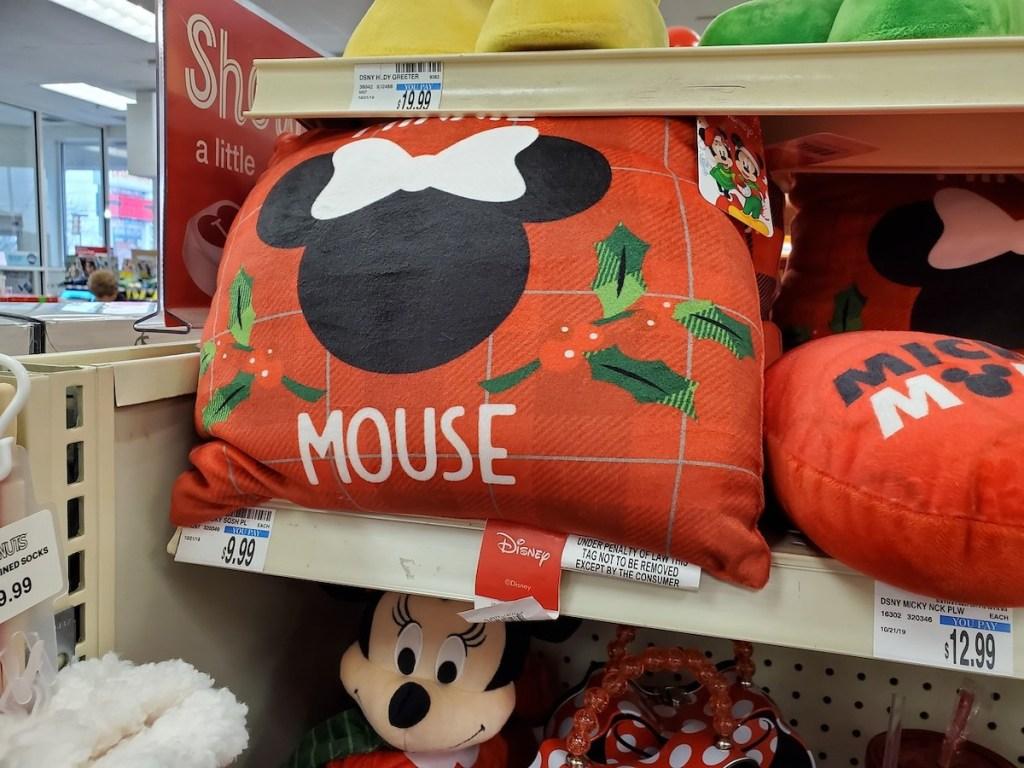 CVS shelf with Minnie Mouse Christmas Pillow