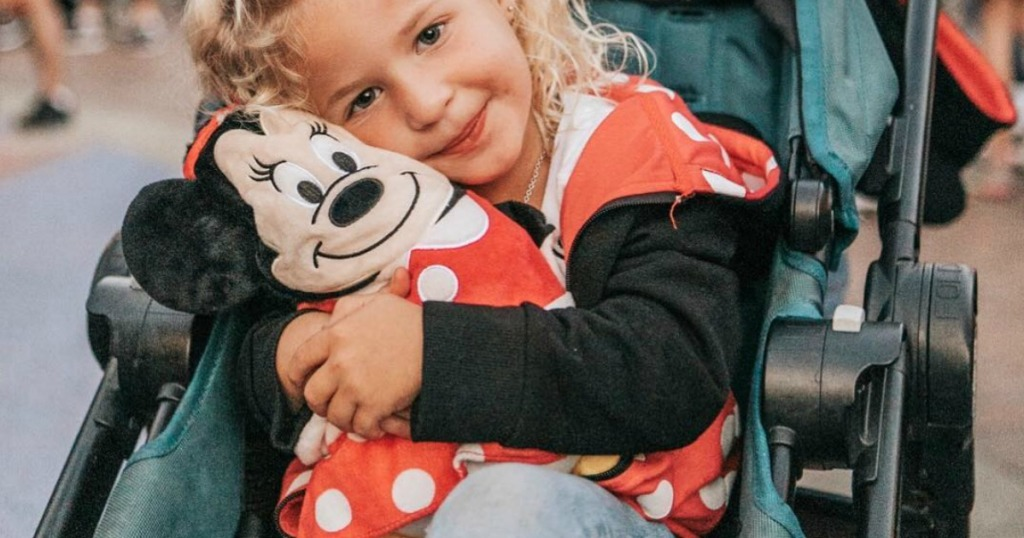 Girl wearing Minnie Mouse Cubcoat in stroller