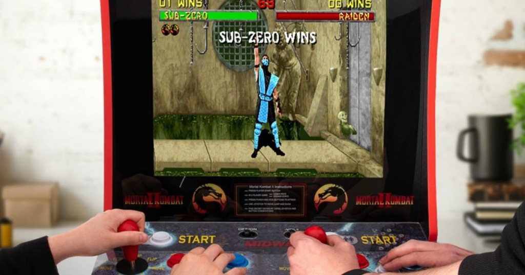 people playing the Moral Kombat Arcade
