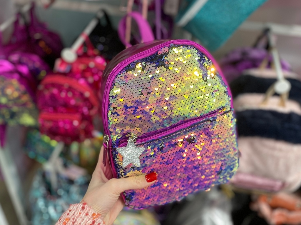 hand holding More Than Magic Sequin Backpack