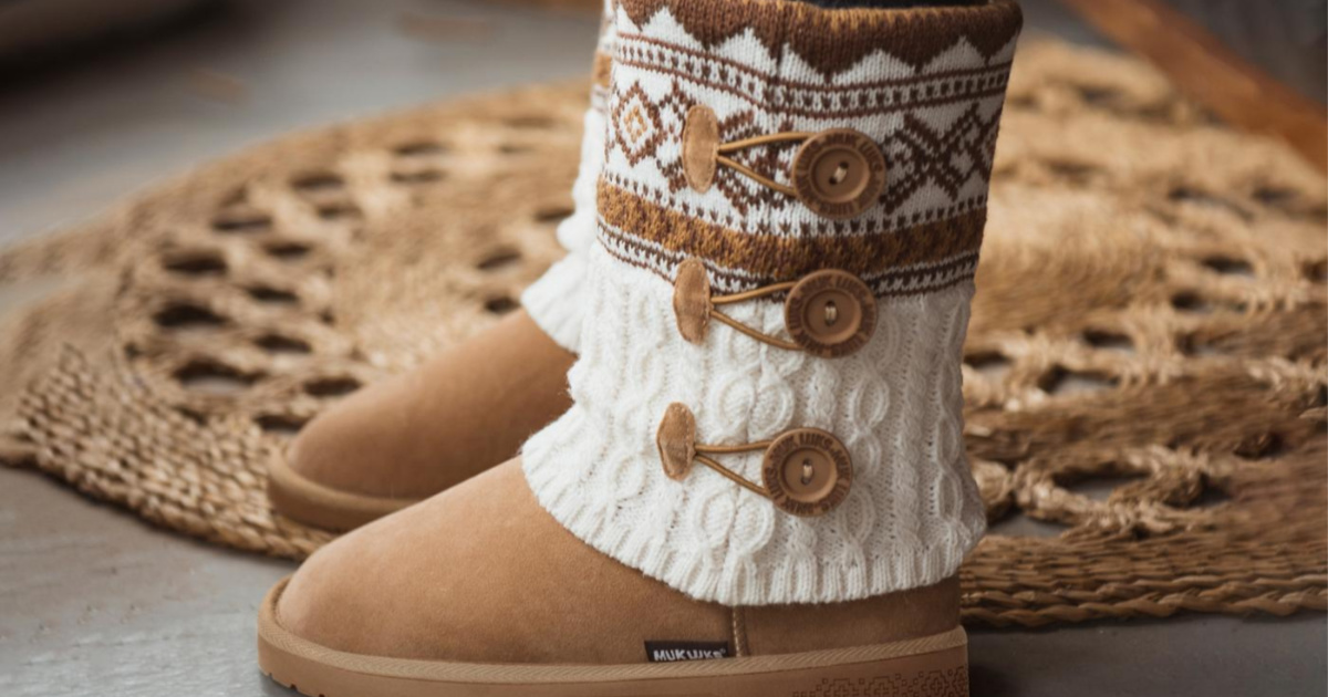 pair of muk luks boots next to a rug