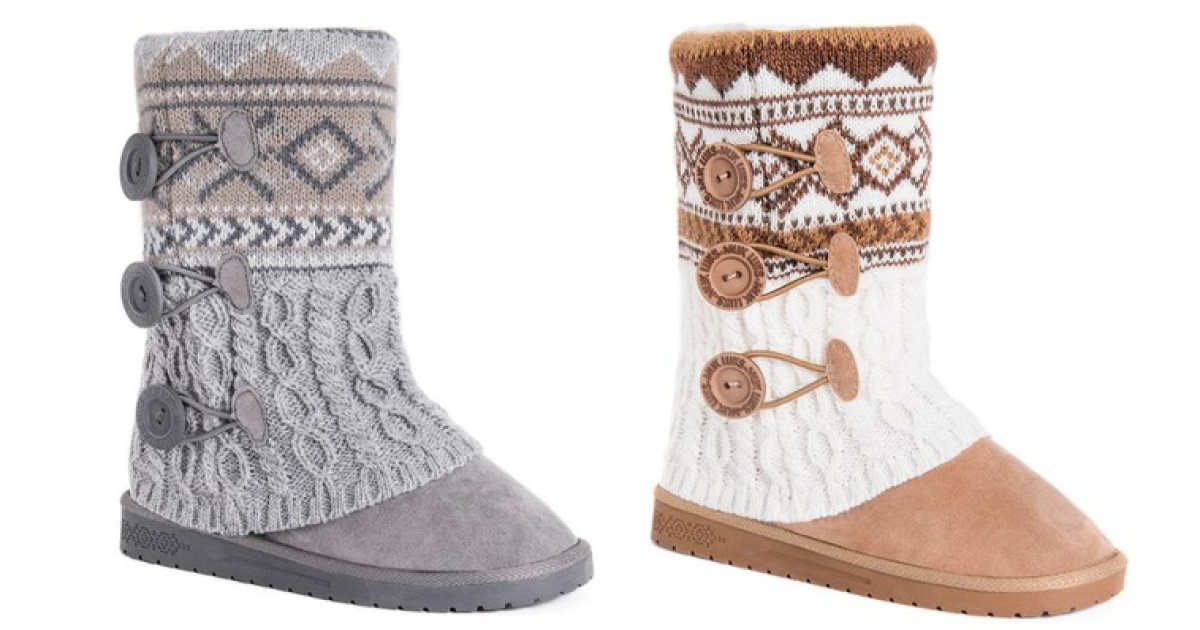 two muk luks boots stock images