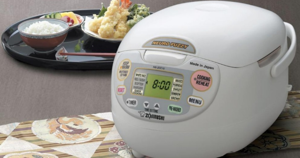 Zojirushi Neuro Fuzzy 10 Cup Rice Cooker and Warmer next to a plate of food