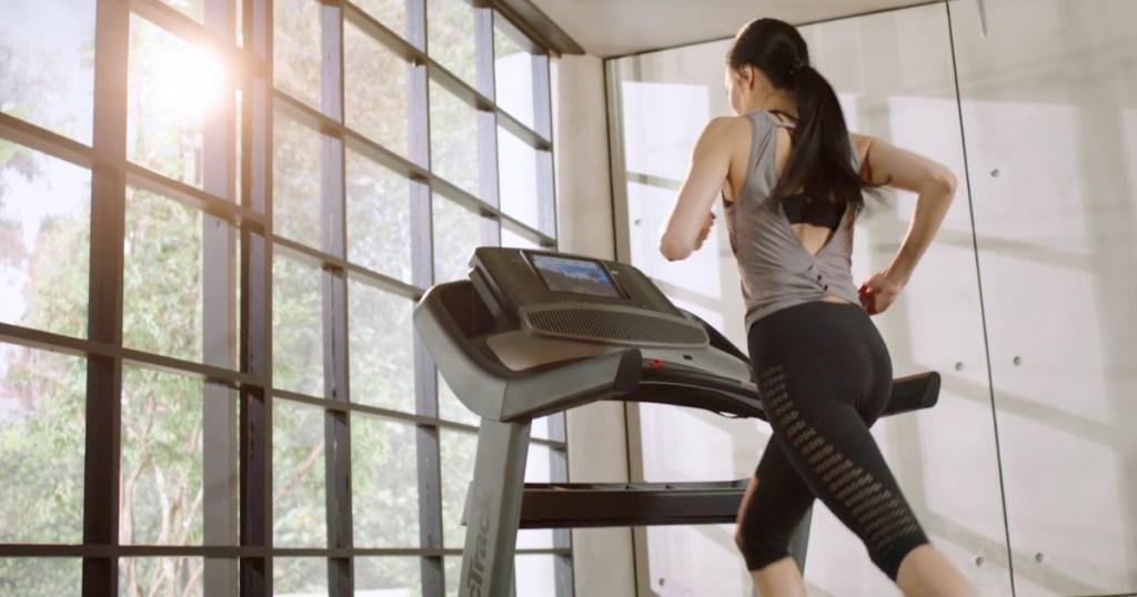 woman running inside on NordicTrack Treadmill 1750