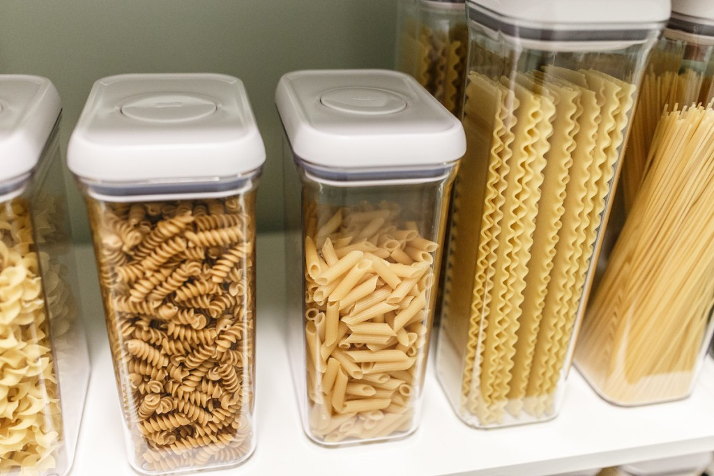 row of pastas inside clear food storage containers