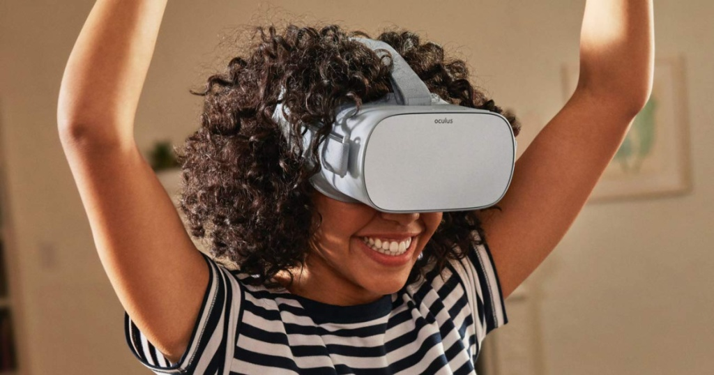 girl wearing Oculus Go Virtual Reality Headset on face in the room
