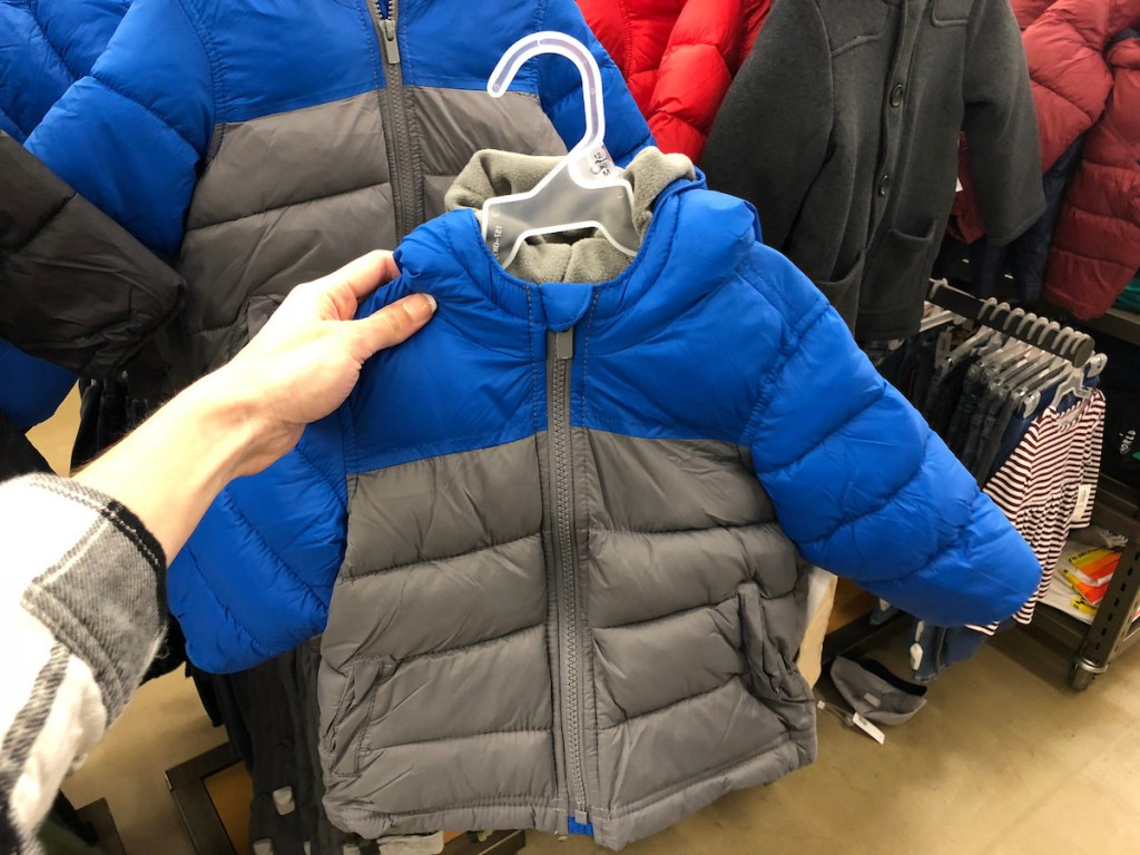 woman holding blue and grey Old Navy Frost Free Jacket in store