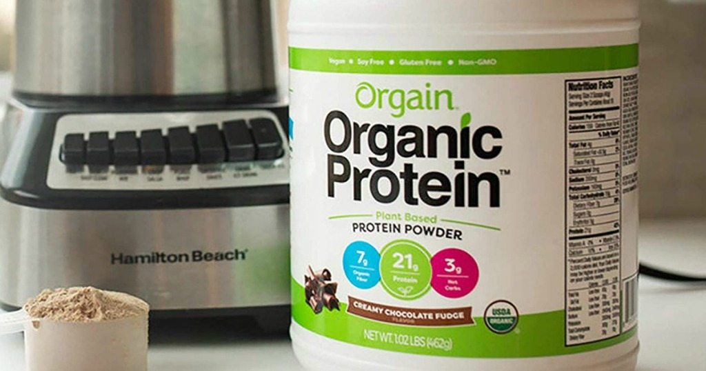 Orgain Organic Protein Powder container next to mixer