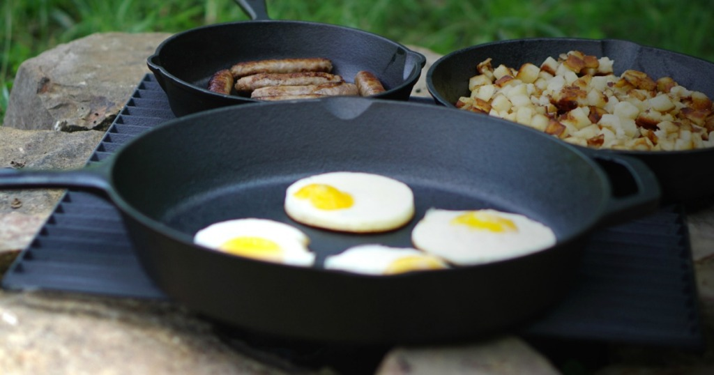 Ozark Cast Iron Skillet three pack with breakfast foods at camp