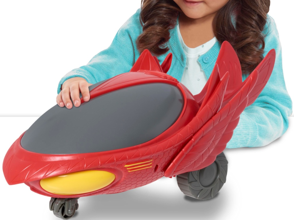 girl with PJ Masks Mega Vehicle Owlette's Owl Glider