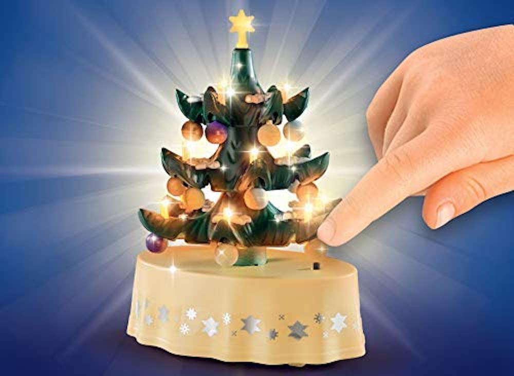 hand turning on the PLAYMOBIL Christmas Tree