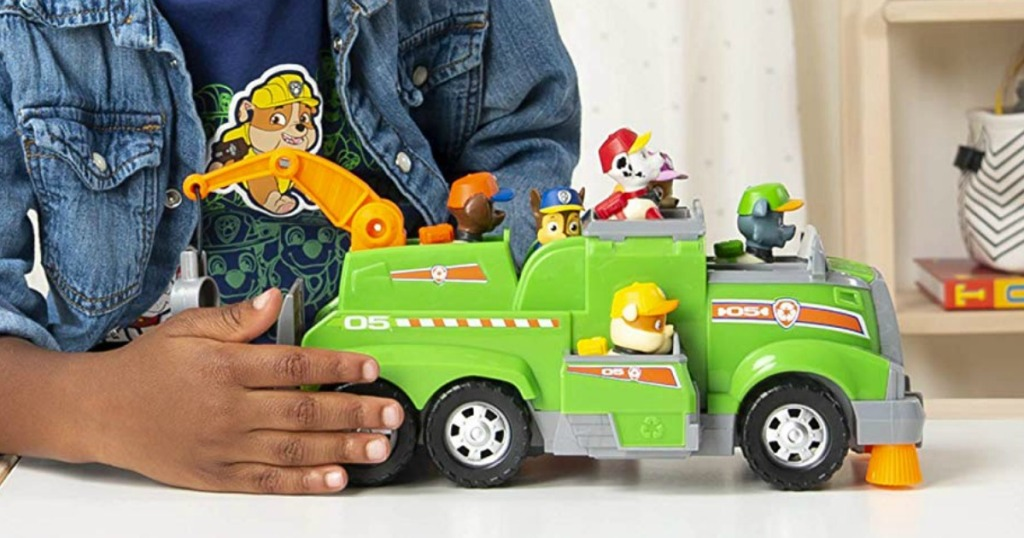 boy playing with Paw Patrol Truck