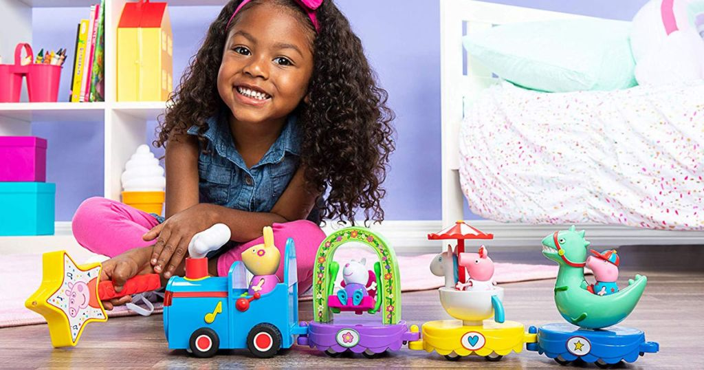 girl playing with Peppa Pig Peppa's Magical Parade in room