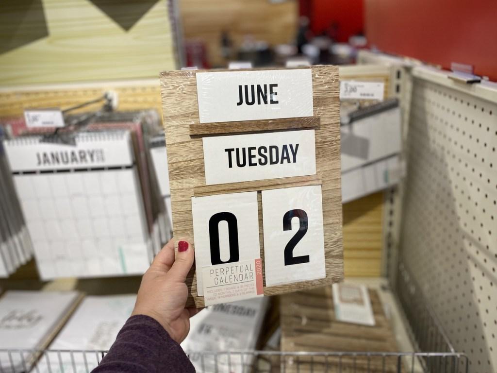 hand holding Perpetual Calendar