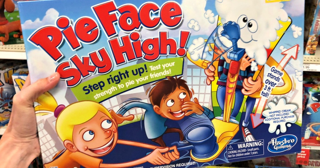 hand holding Pie Face Sky High Game