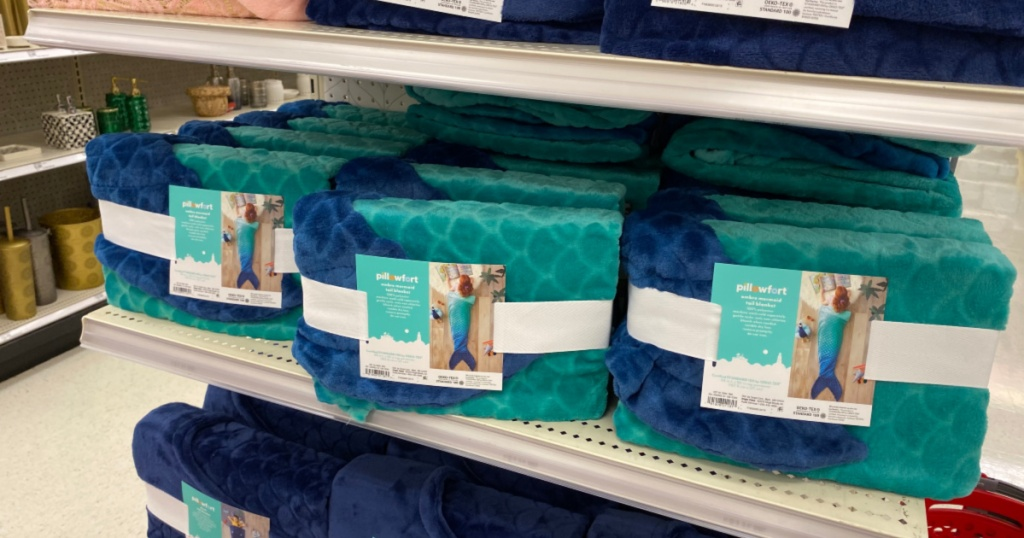 shelf with Pillowfort Blue Ombre Mermaid Tail Blanket