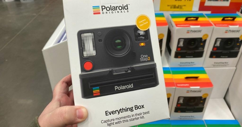 woman holding a Polaroid Everything Box