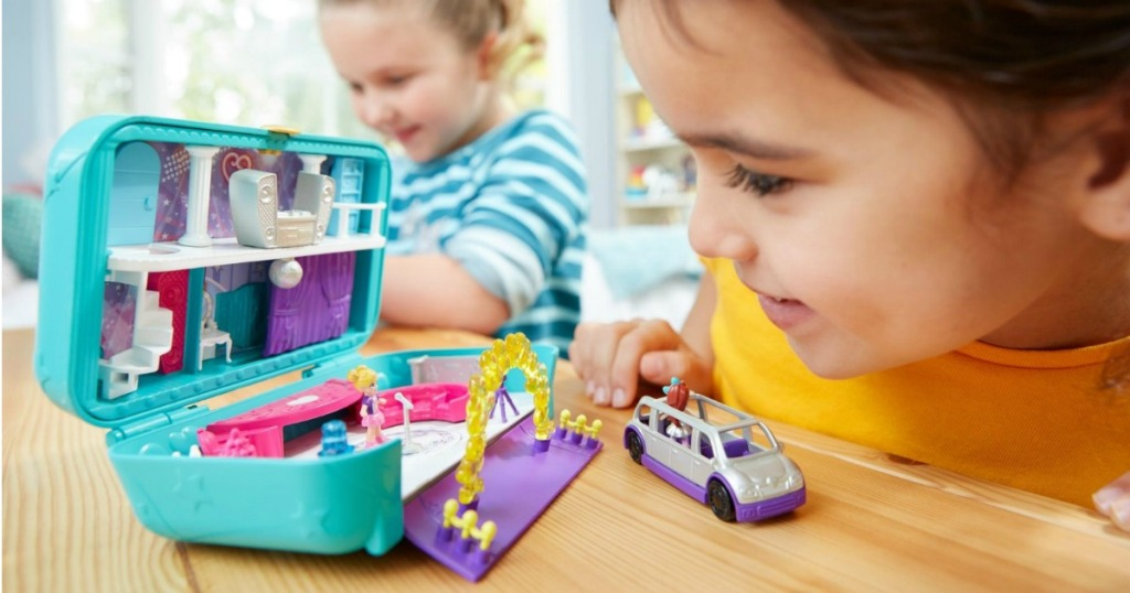 Girl playing with Polly Pocket Hidden Party Set