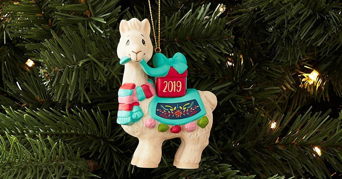 Precious Moments 2019 llama Christmas ornament hanging in a Christmas tree