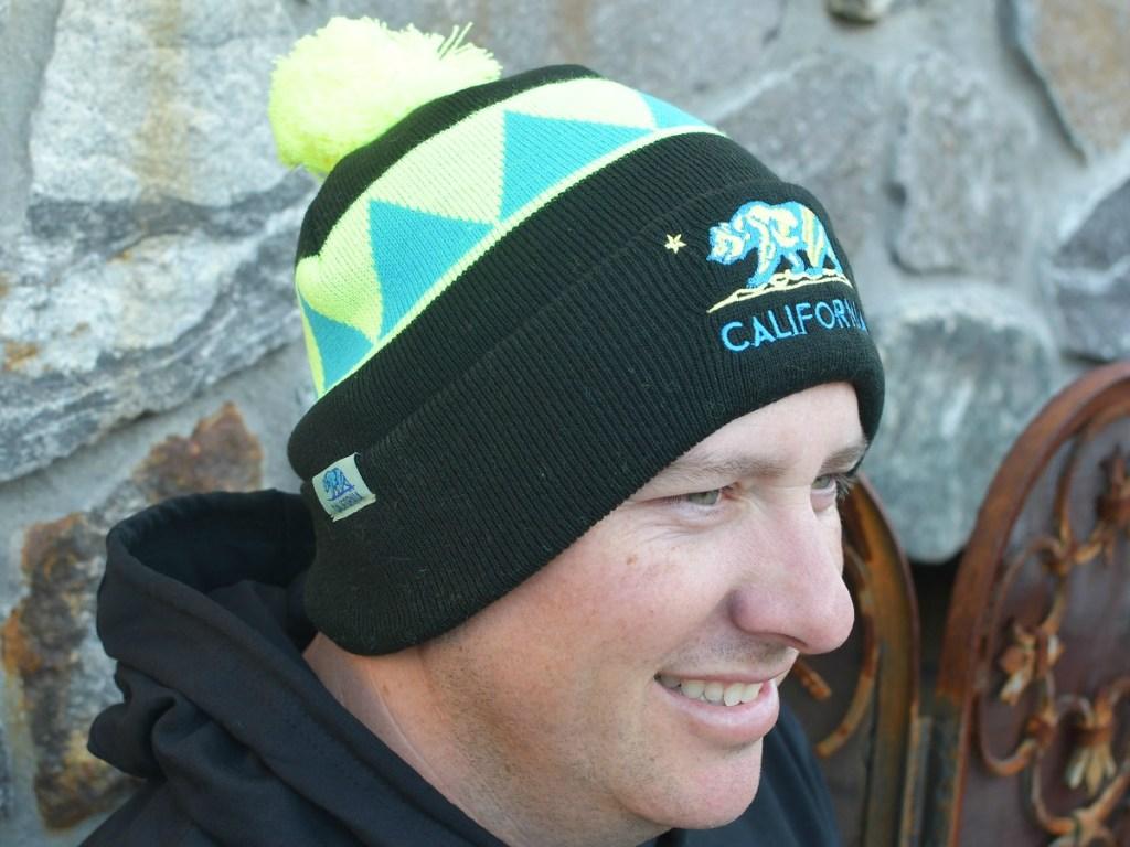 Man wearing California beanie hat outdoors
