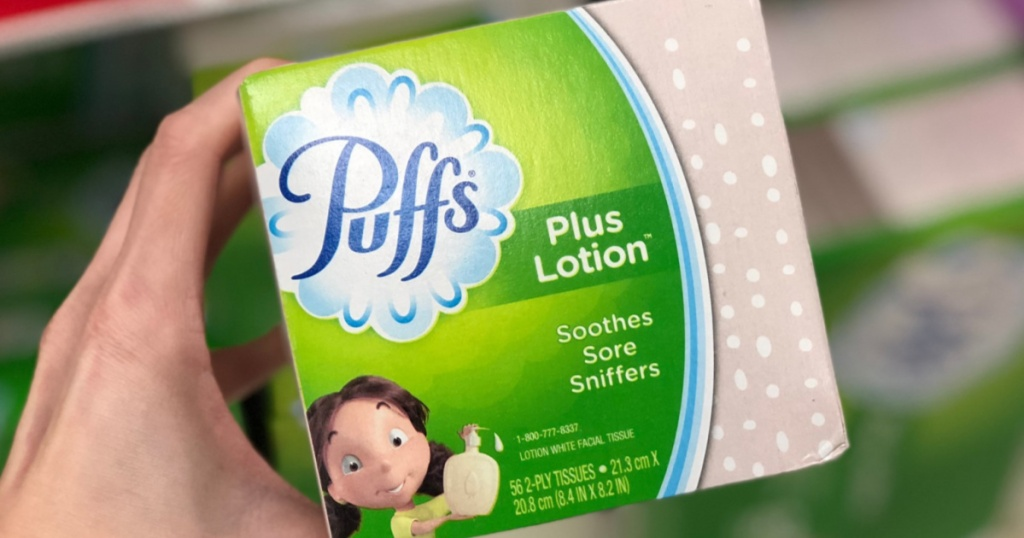 Hand holding Puffs Plus with Lotion