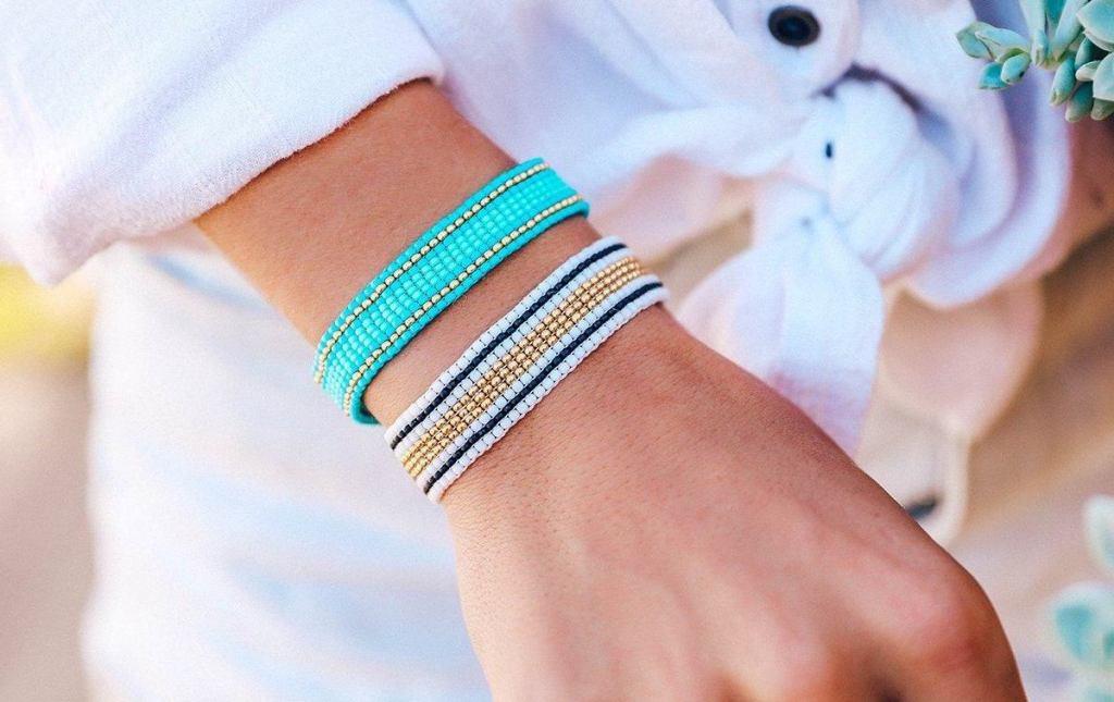 person wearing Pura Vida Beaded Bracelets
