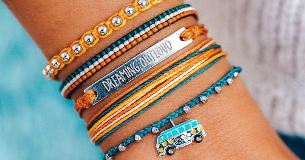 person wearing Pura Vida bracelets