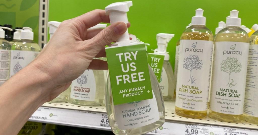 hand holding bottle of Puracy Hand Soap