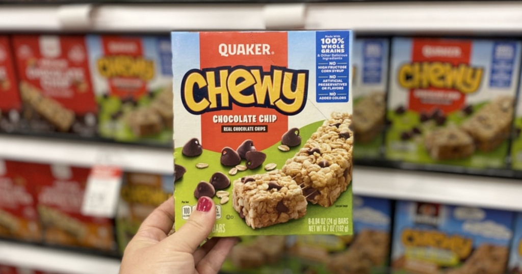Hand holding Quaker Chewy Granola Bars at Target