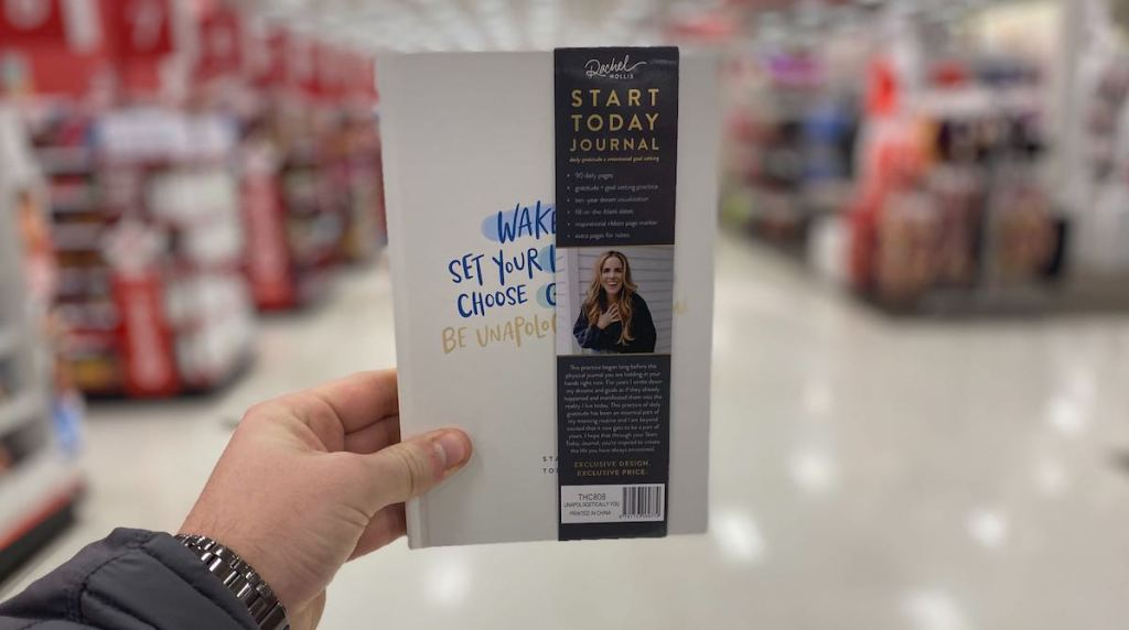 hand holding a Rachel Hollis Unapologetically You Journal at Target
