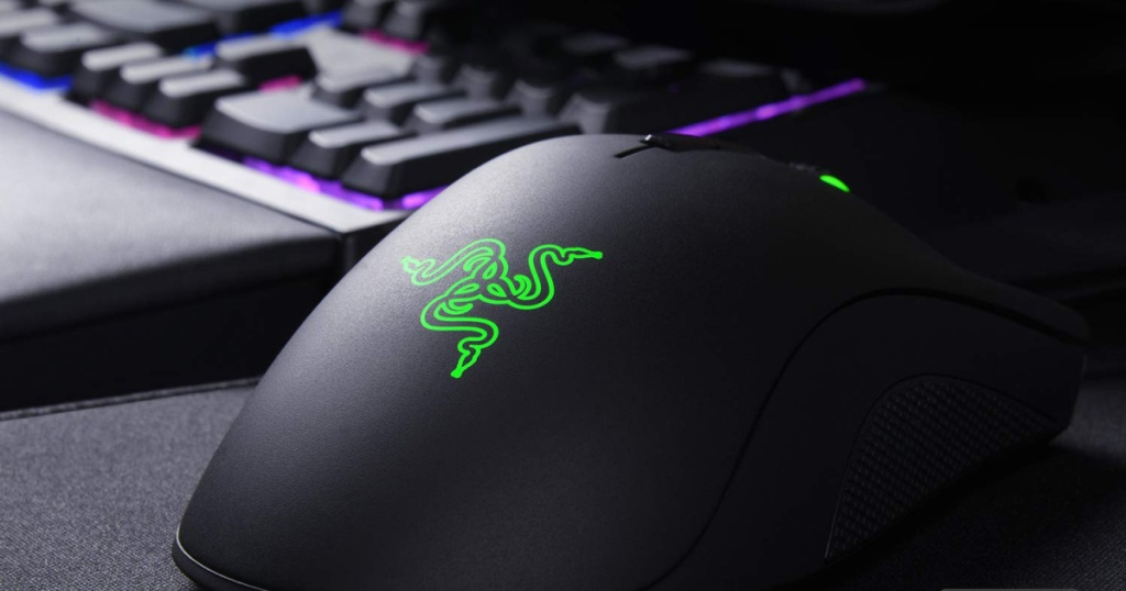 Razer DeathAdder Elite Gaming Mouse with lit up gaming keyboard in the background