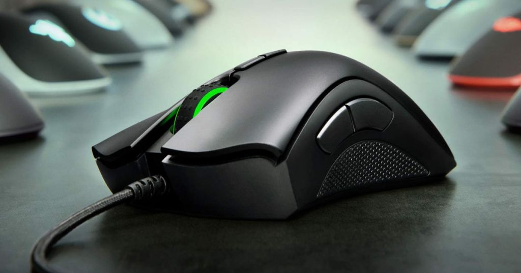 Razer DeathAdder Elite Gaming Mouse on table with other mouse in the background