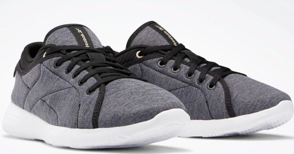 gray Reebok shoes with black trim