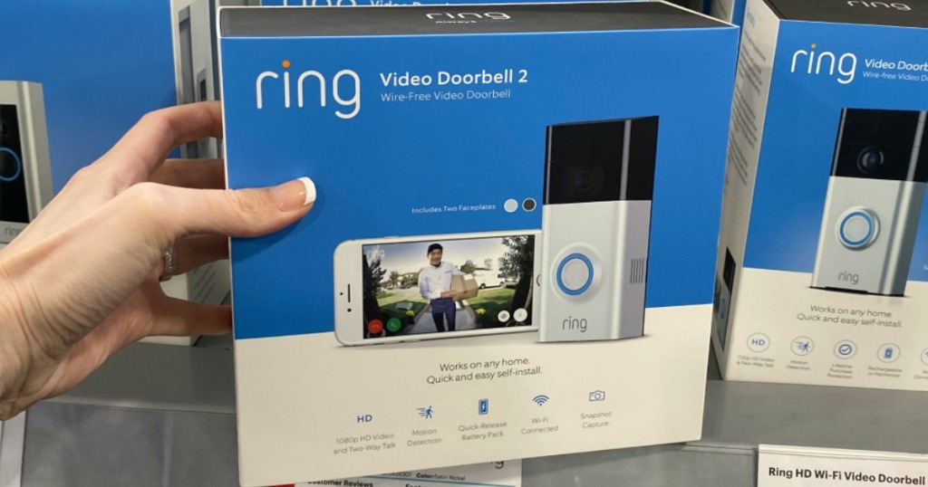 hand holding box of a Ring Video Doorbell 2