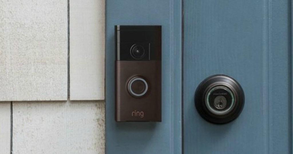 Ring video doorbell installed in blue doorway