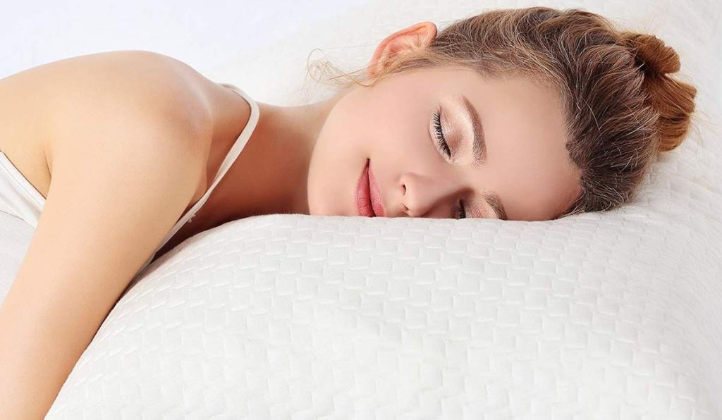 woman laying on a memory foam pillow