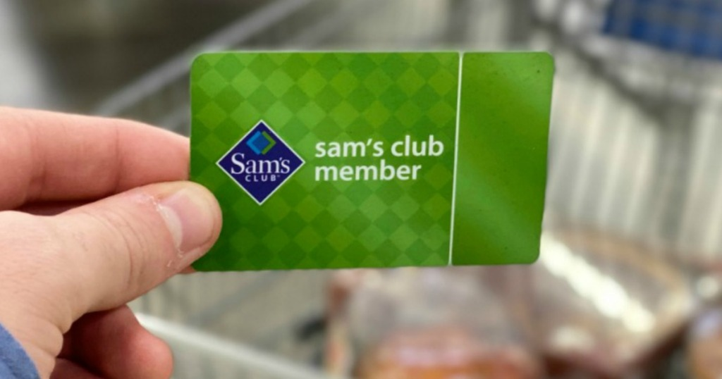 Man holding a Sam's Club Membership card