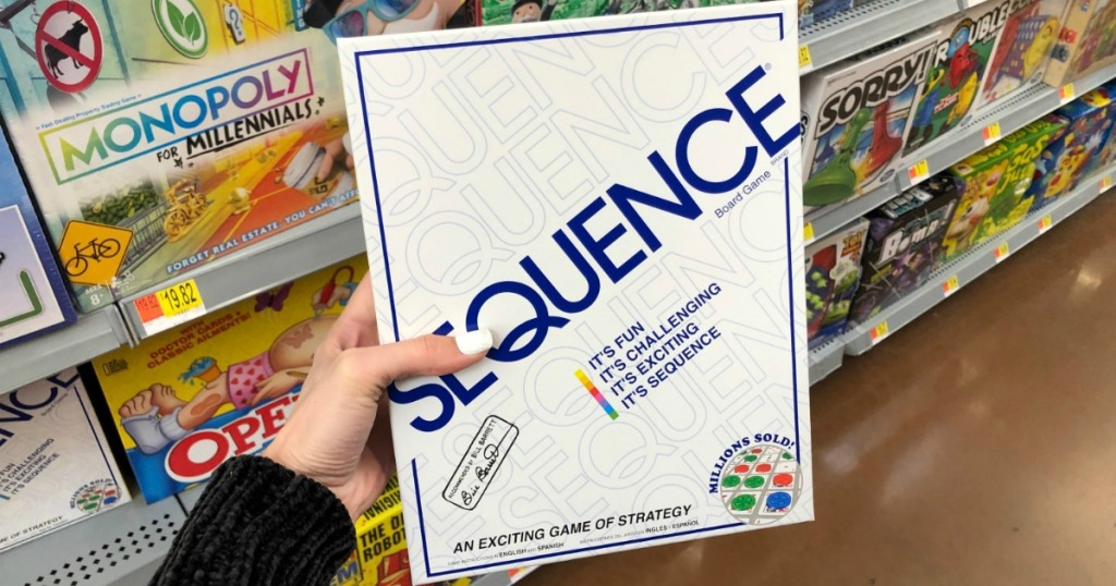 Sequence Board Game in hand in store near board game aisle