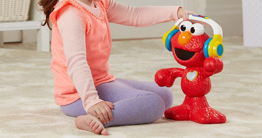 girl playing with Sesame Street Let's Dance Elmo