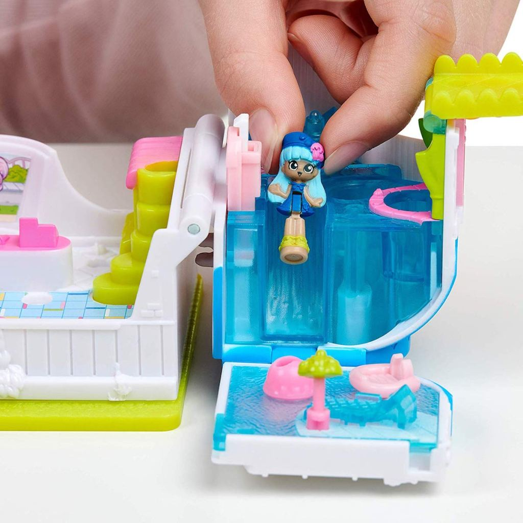 girl playing with tiny doll on Shopkins Lil Secrets Mini Playset - Cool Scoops Café