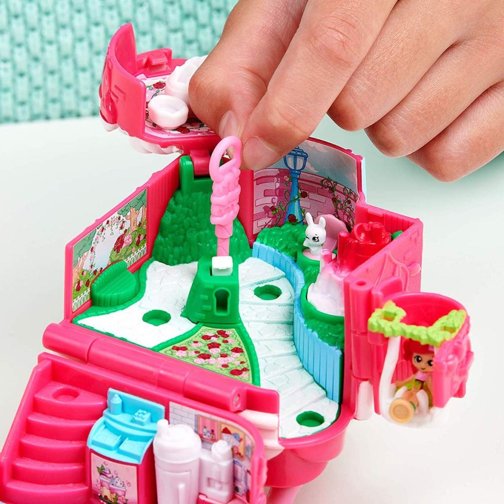 child hand playing with Shopkins Lil Secrets Mini Playset - Rosie Bloom Café
