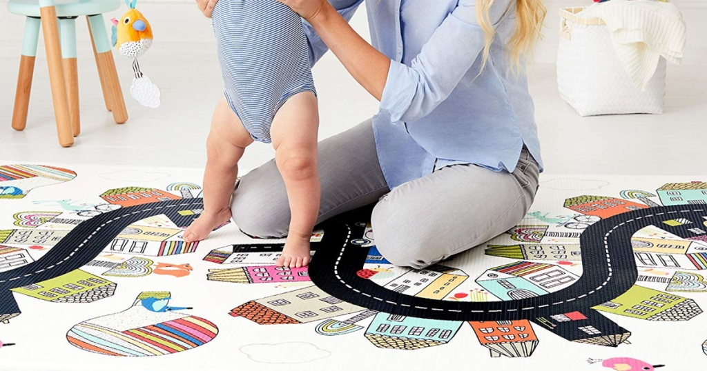 mom and baby playing on skip hop reversible playmat