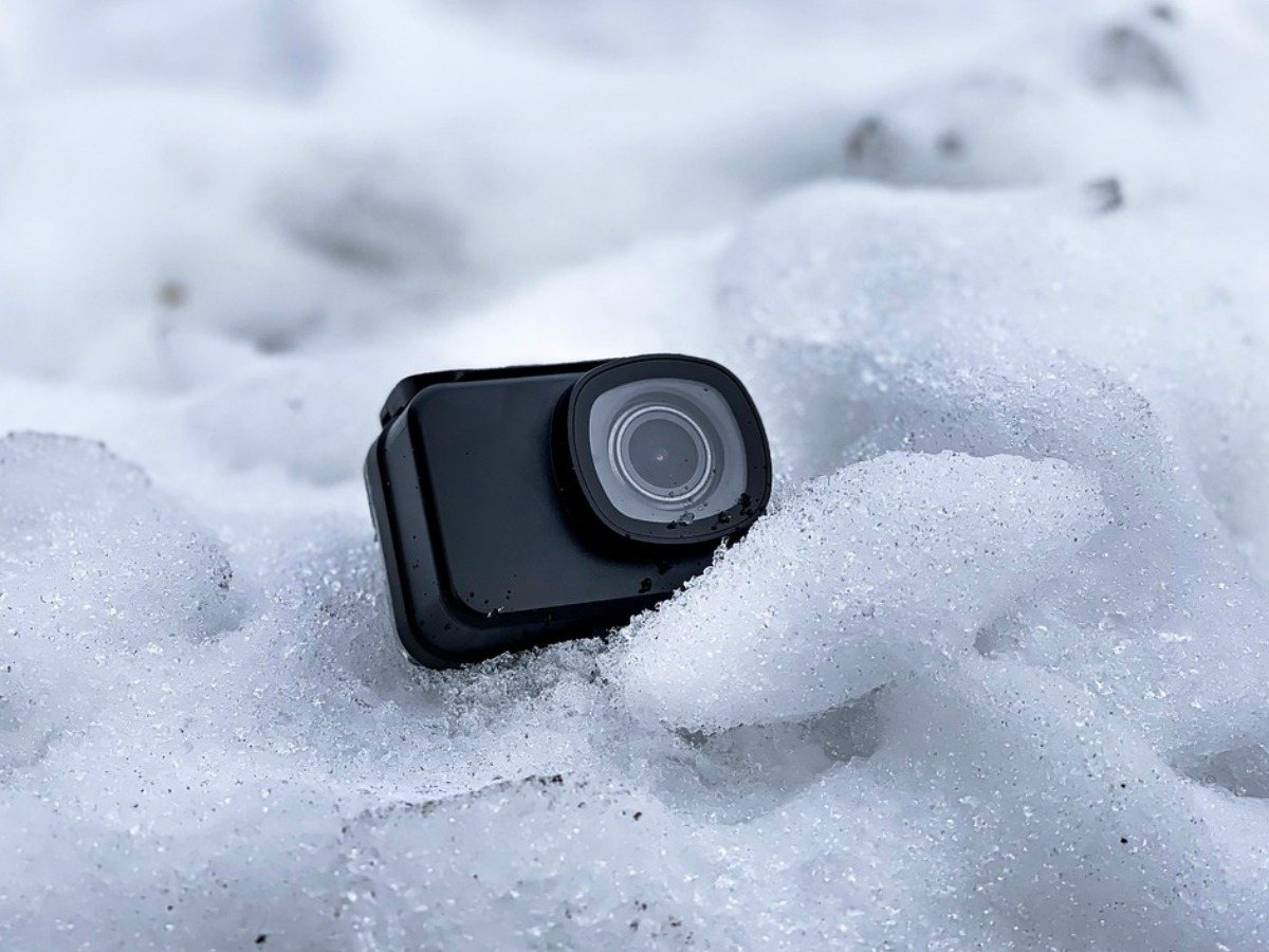 small action camera in the snow