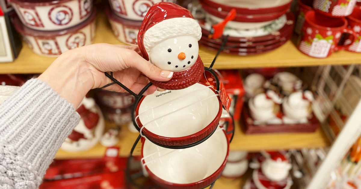 Hand holding a snowman-themed two-tier serving tray