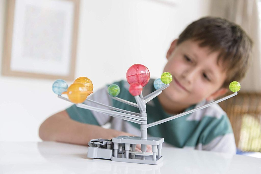 Boy with a Solar System Kit